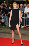 Charlize Theron shows legs wearing deep slit black dress Hancock UK Premiere in London