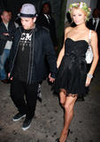 Paris Hilton shows cleavage an legs in small black dress partying at Tao nightclub in New York